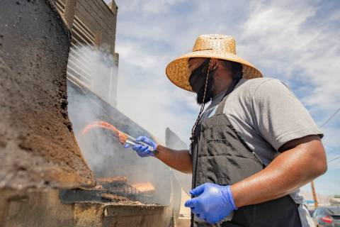 Annie's Kitchen pit master Quincy Reynolds, prepares ribs at the restaurant on Wednesday, April ...
