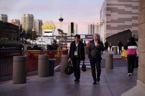 Visitors leave CES on the final evening of the convention at the Las Vegas Convention Center in ...