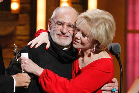 FILE -This June 12, 2011 file photo shows Larry Kramer, left, and Daryl Roth embracing after th ...