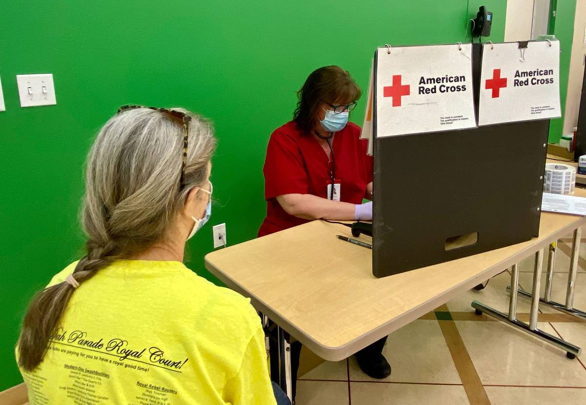 A blood donor checks in at a recent American Red Cross blood drive held at the Girl Scouts of S ...