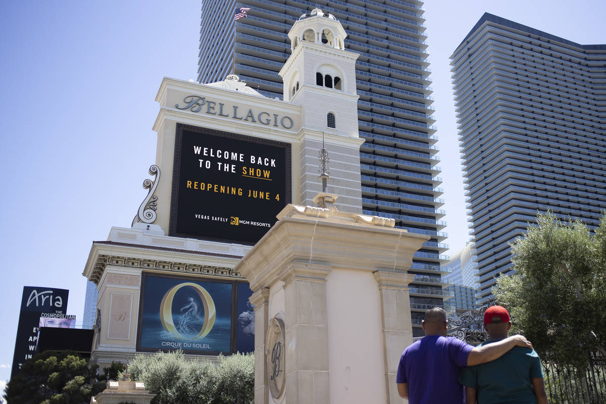 The Bellagio marquee says the hotel and casino, owned big MGM Resorts International, will open ...