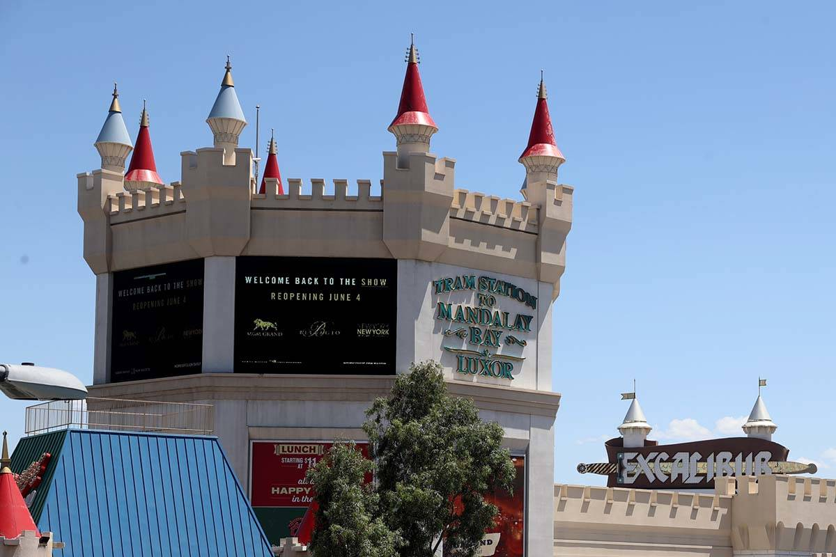 A digital sign at Excalibur announces the reopening of some MGM Resorts International casinos o ...