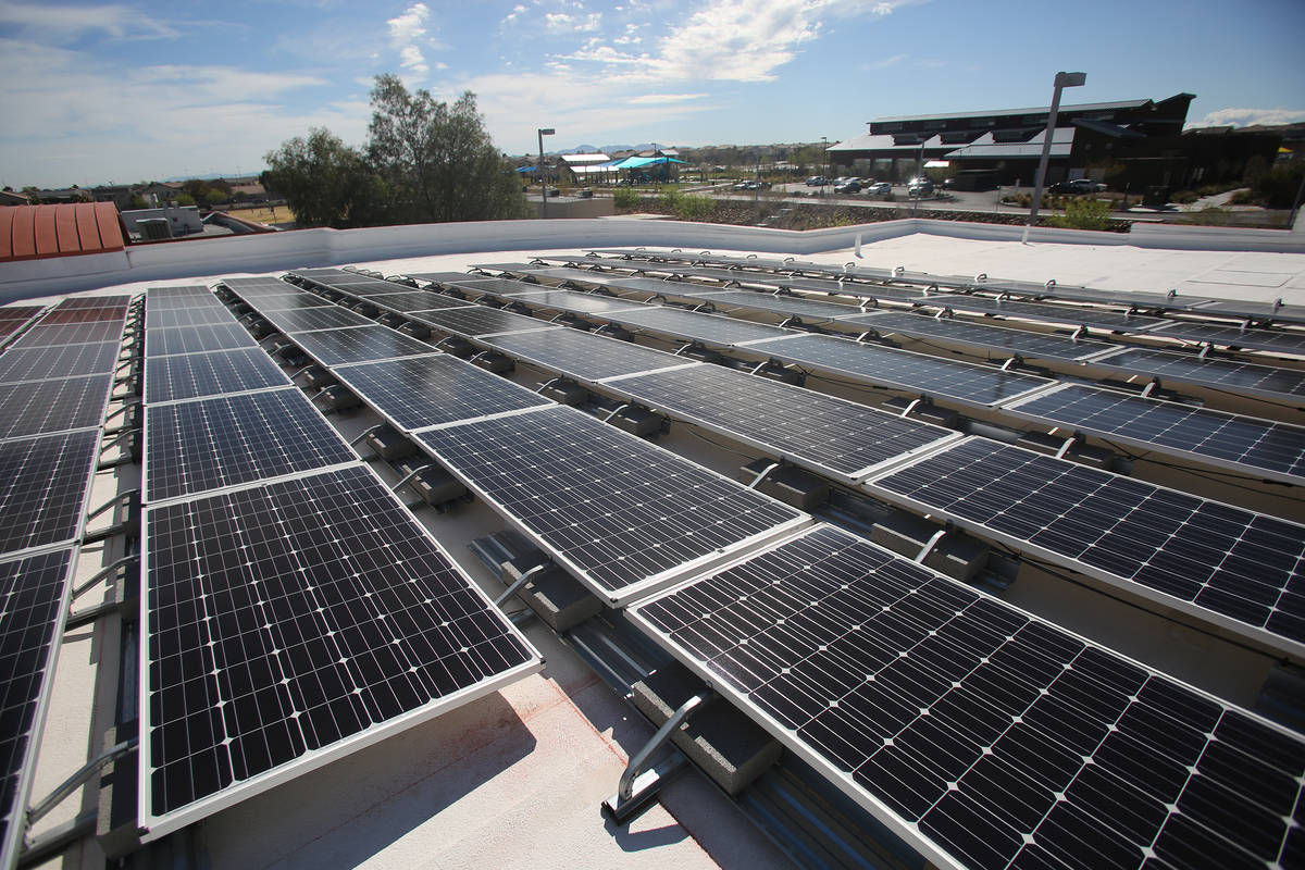In this March 12, 2018, file photo, solar panels line the roof of Wilbur and Theresa Faiss Midd ...