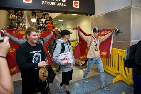 Southern Nevada Blue Sox baseball players arrive at McCarran International Airport in Las Vegas ...