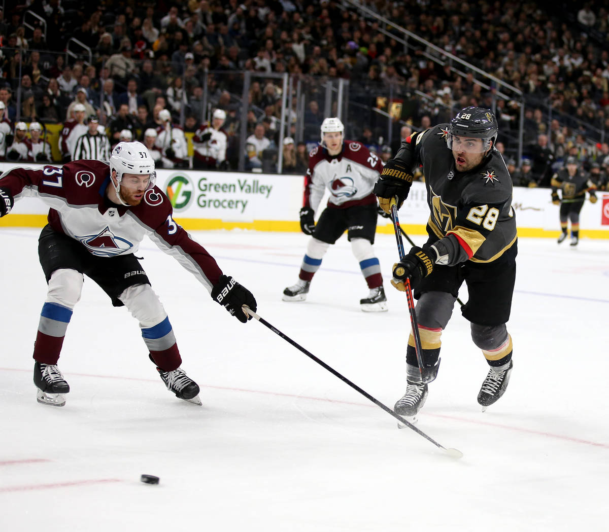 Vegas Golden Knights left wing William Carrier (28) shoots past Colorado Avalanche left wing J. ...