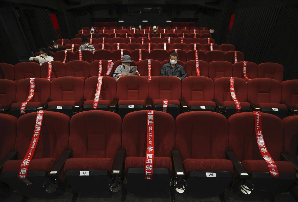 CORRECTS SLUG: Red tape blocks off some seats in an attempt to promote social distancing at a m ...