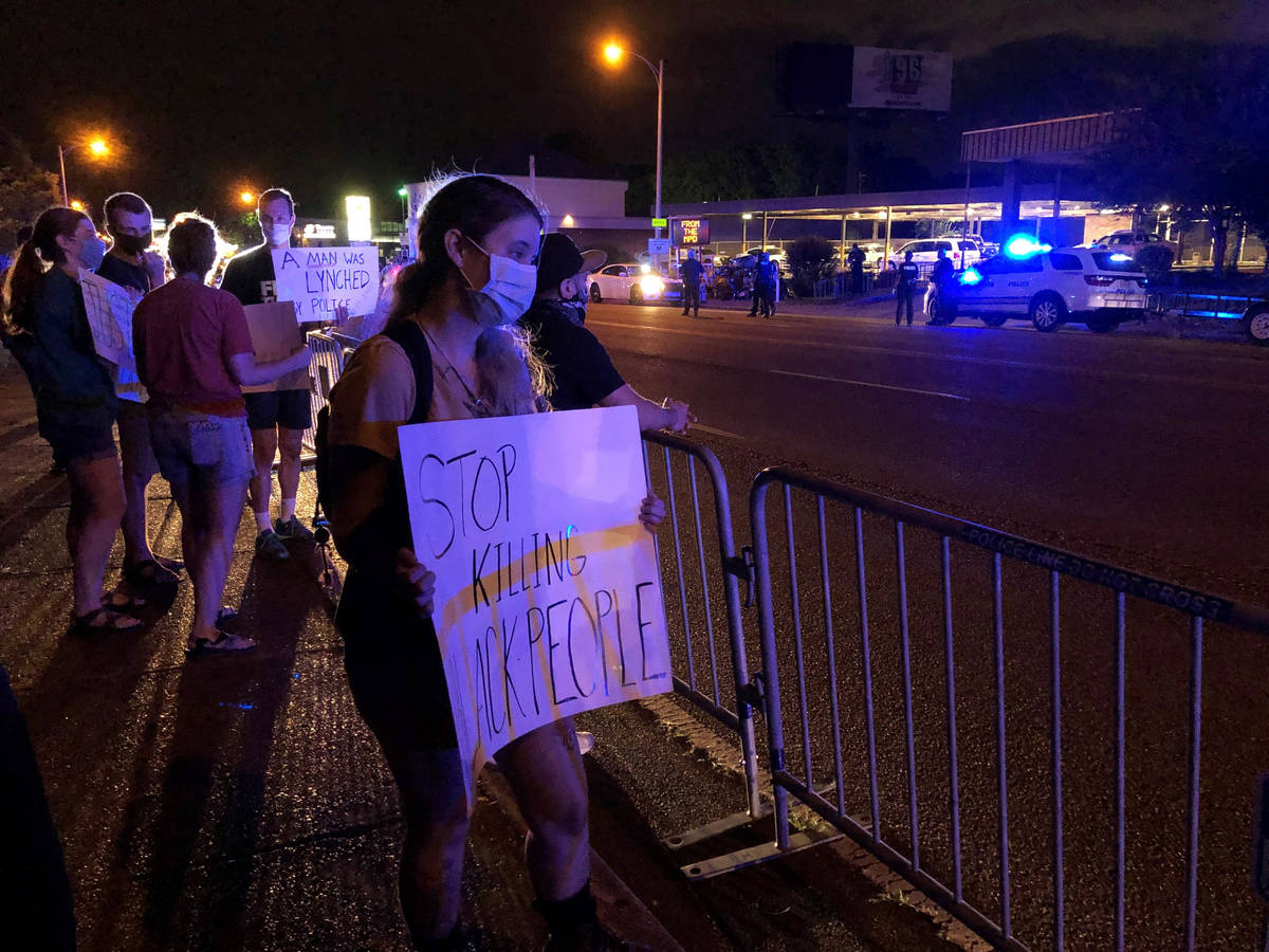 Protesters in Memphis, Tenn.. gather outside a police precinct Wednesday, May 27, 2020, to voic ...