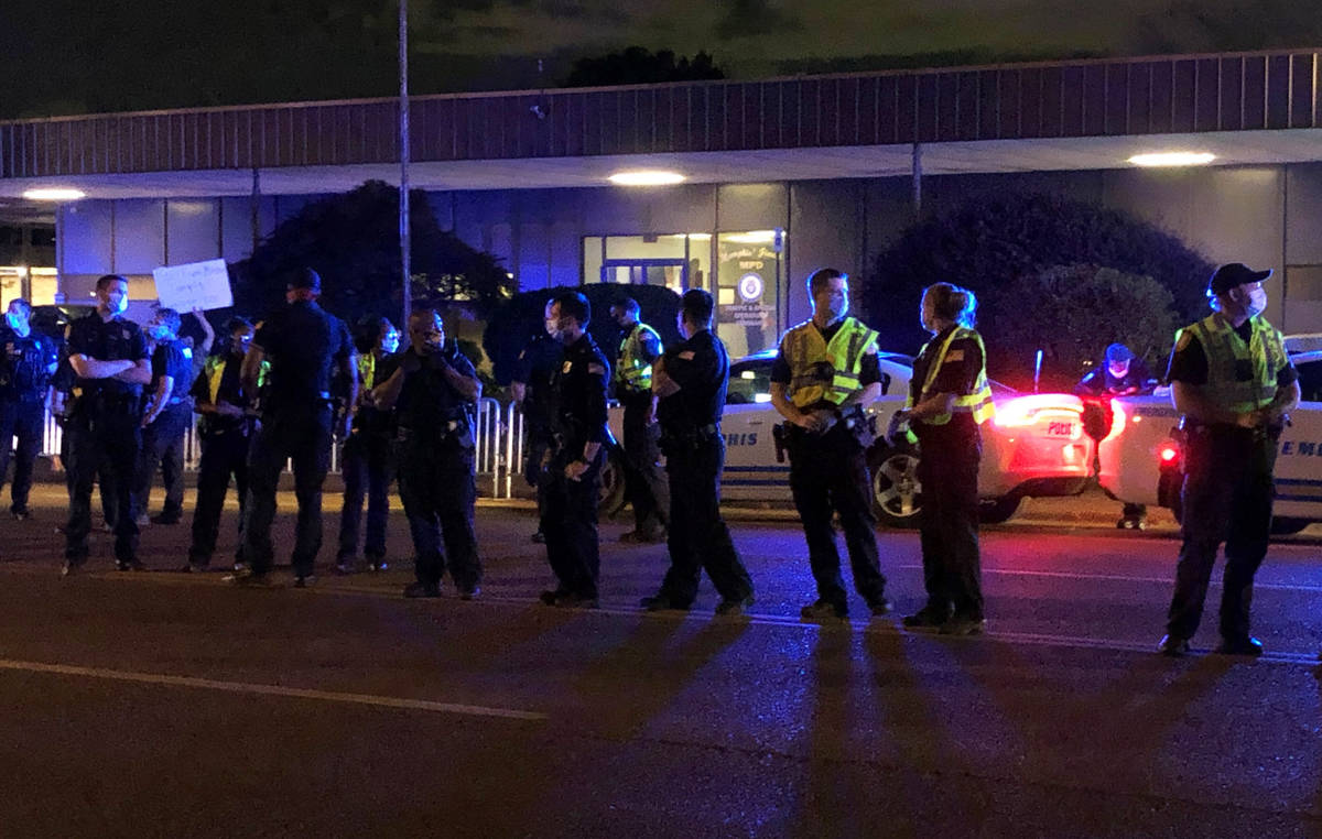 Officers form a line in front of a police precinct Wednesday, May 27, 2020, in Memphis, Tenn., ...