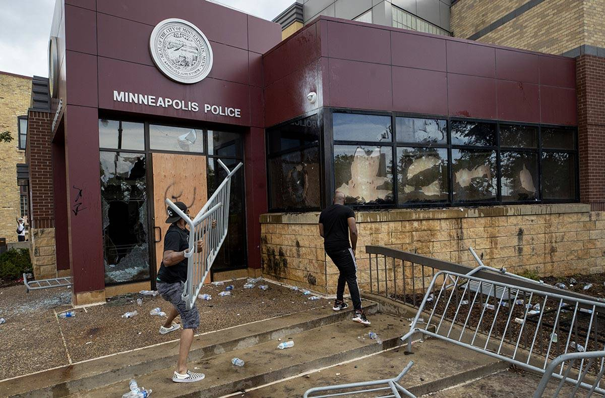 Protesters damage properties at the Minneapolis 3rd Police Precinct in Minneapolis on Wednesday ...