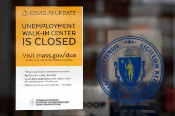 A sign announces the closure of the Massachusetts Unemployment Office, Saturday, May 9, 2020, i ...