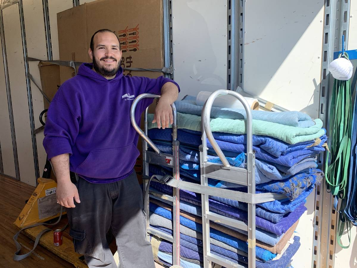 Carlos Ibarra, Move 4 Less team member, is ready to help four local families through the compan ...