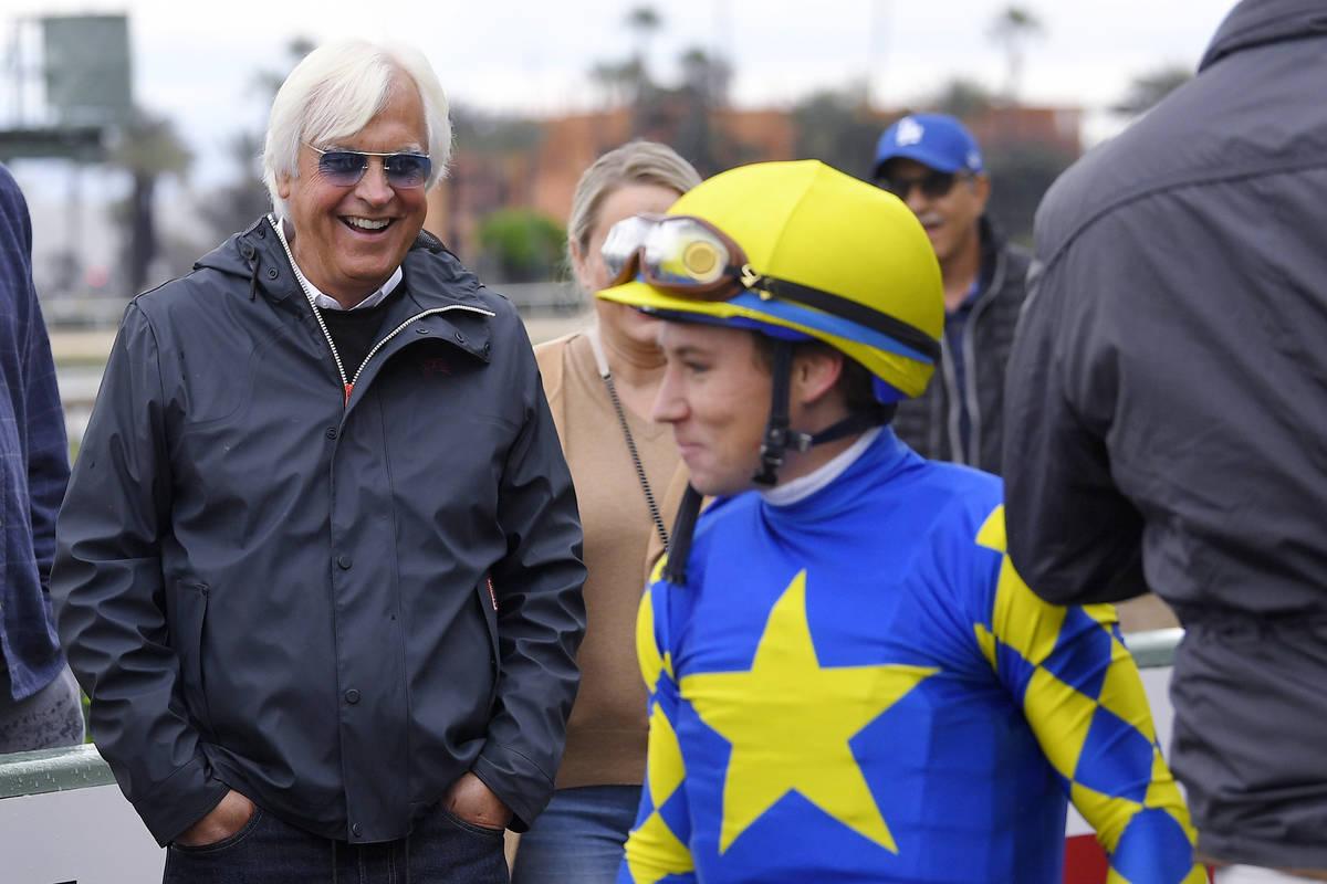 Trainer Bob Baffert, left, laughs after jockey Drayden Van Dyke dismounted Charlatan following ...
