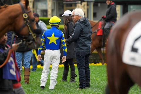 Jockey Drayden Van Dyke, left, talks with trainer Bob Baffert before riding Charlatan in the si ...