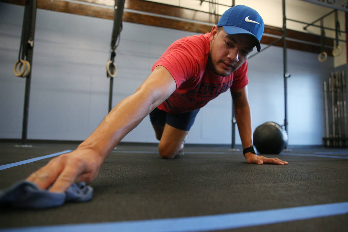 Peter Rivera cleans his space after working out at Crossfit Apollo in Las Vegas, Friday, May 29 ...