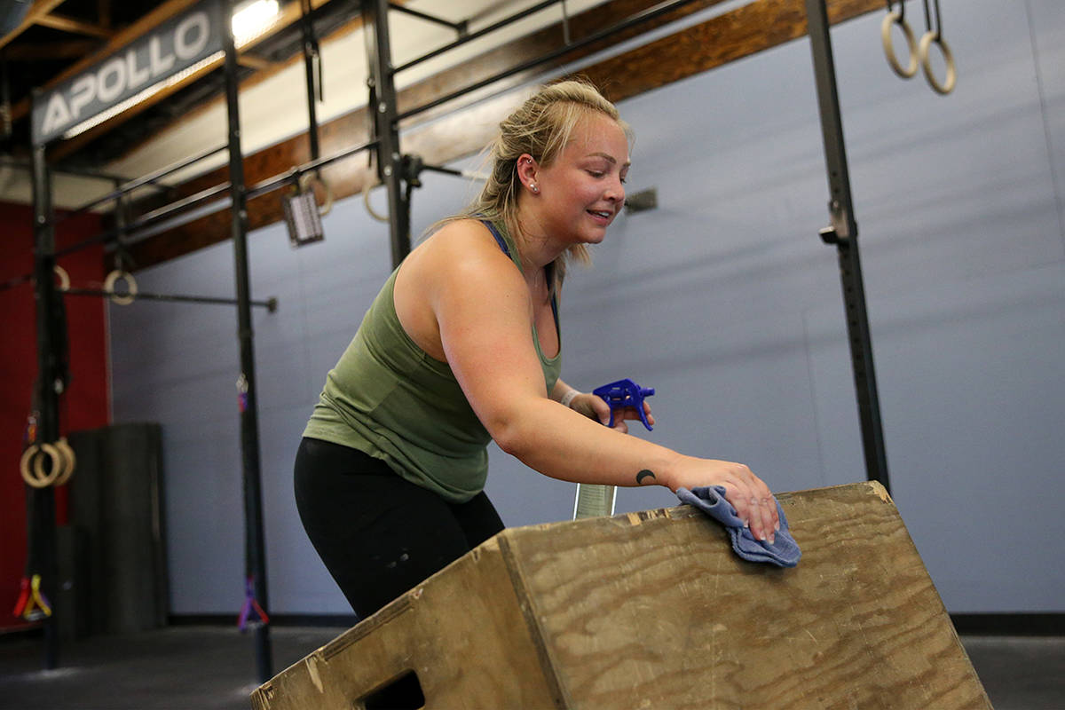 Kelci Swartz cleans her equipment after working out at Crossfit Apollo in Las Vegas, Friday, Ma ...
