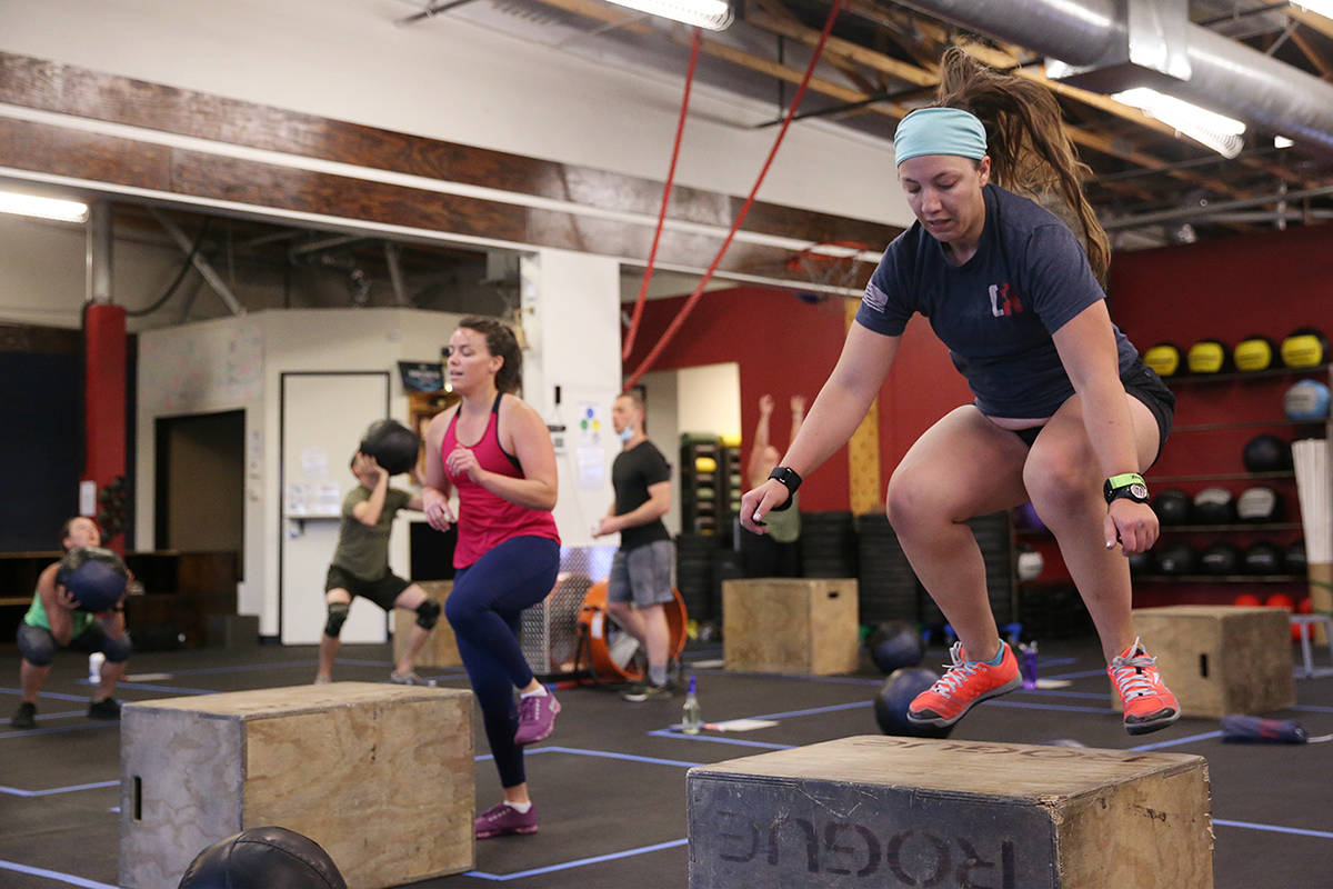 Nicole Perhala, left, and Skye Mooibroek, workout during a class at Crossfit Apollo in Las Vega ...