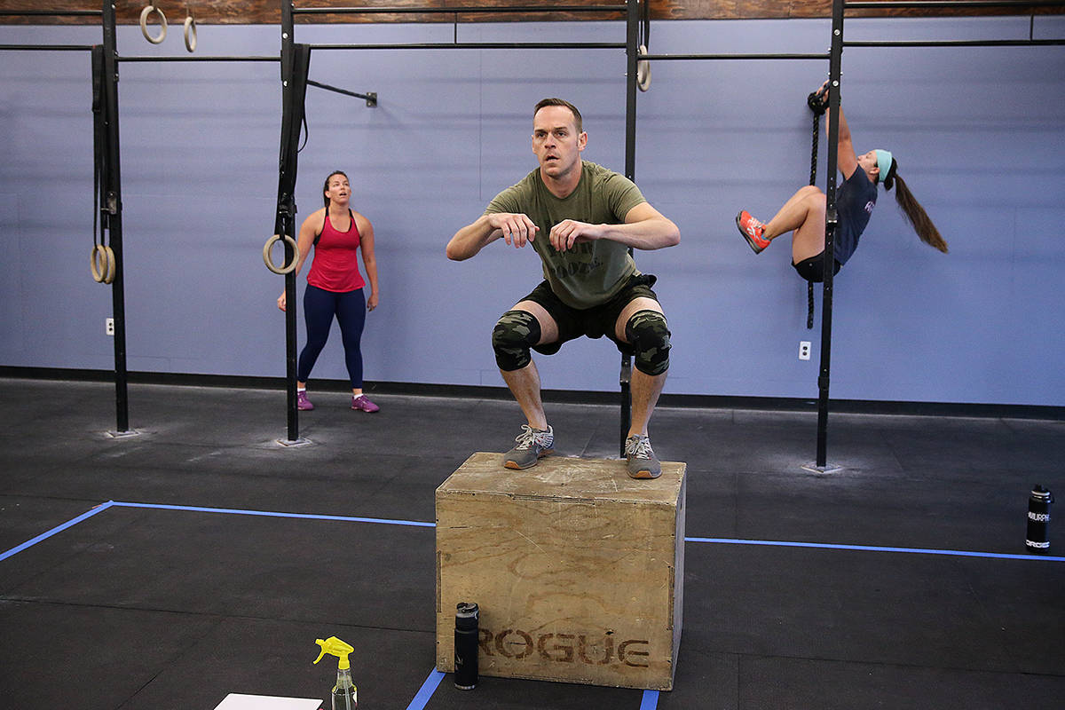 Sam Dukes, center, works out during a class at Crossfit Apollo in Las Vegas, Friday, May 29, 20 ...