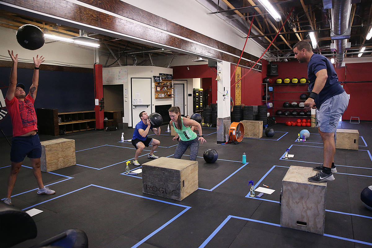 People workout while maintaining social distance during the first class after the state shutdow ...