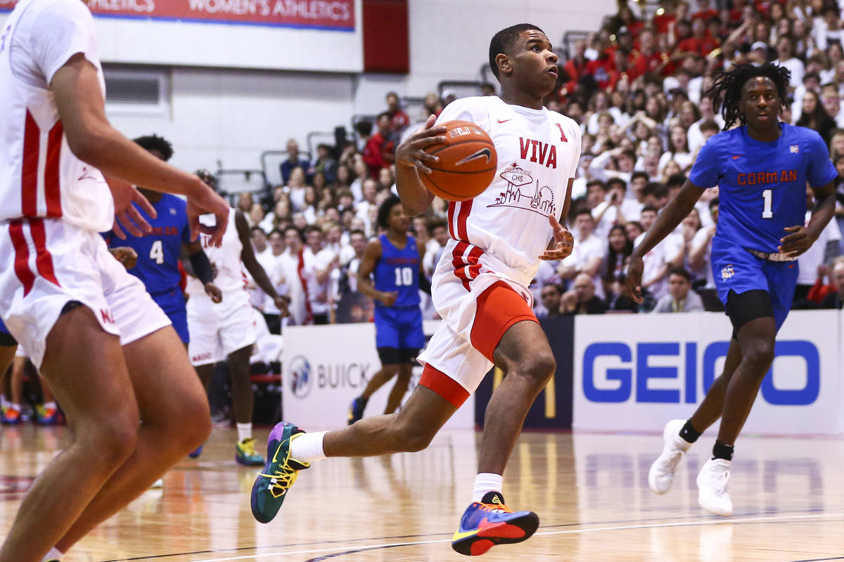 Coronado's Jaden Hardy (1) drives to the basket against Bishop Gorman's Will McClendon (1) duri ...