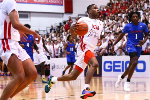 Coronado's Jaden Hardy (1) drives to the basket against Bishop Gorman's Will McClendon (1) duri ...