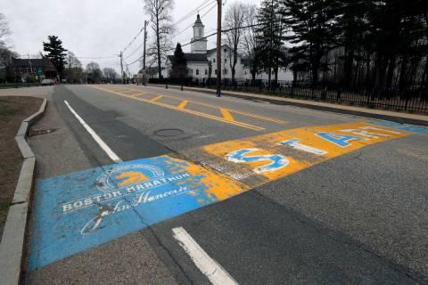 In this Monday April 20, 2020 file photo, the Boston Marathon start line in Hopkinton, Mass., i ...