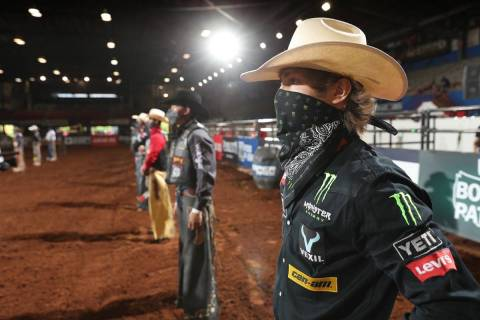 PBR bull rider Derek Kolbaba (foreground) and his fellow cowboys stand before the PBR becomes t ...