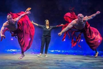 Resident choreographer Danita Eldridge, middle, gives direction to Jakub Dominiak, left, and A. ...