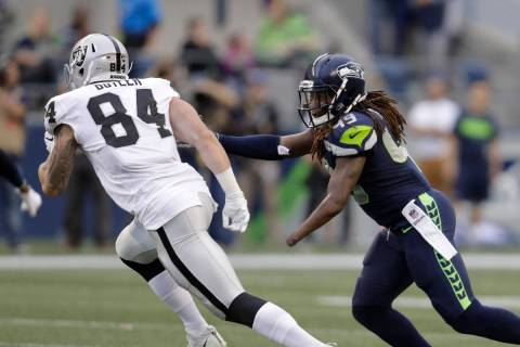 Seattle Seahawks linebacker Shaquem Griffin (49) pursues Oakland Raiders tight end Paul Butler ...