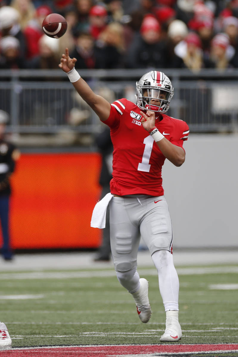 Ohio State quarterback Justin Fields throws a pass against Maryland during the first half of an ...