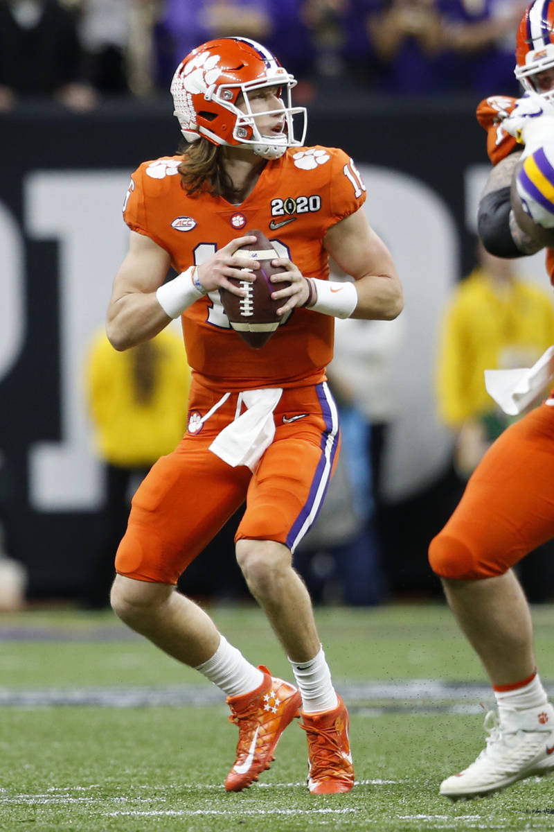 Clemson quarterback Trevor Lawrence looks to pass against LSU during the first half of a NCAA C ...