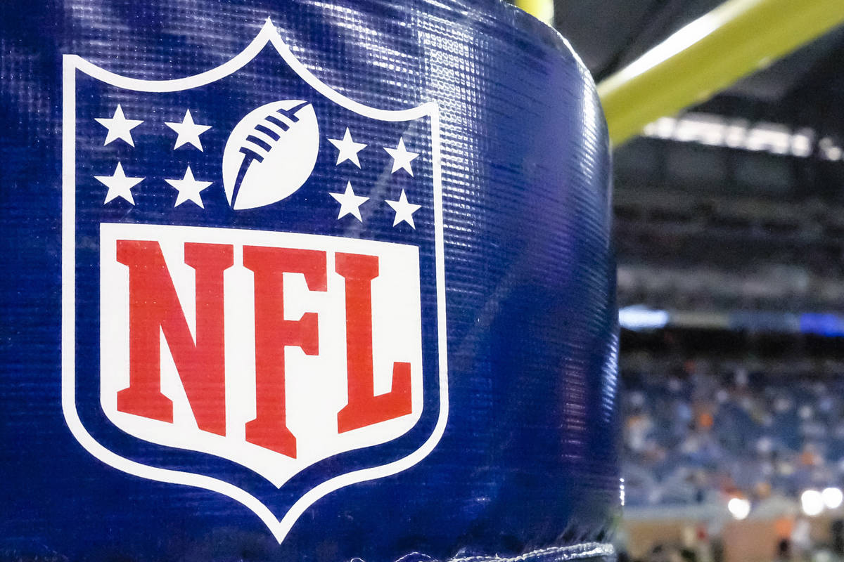 This Aug. 9, 2014 file photo shows an NFL logo on a goal post pad before a preseason NFL footba ...