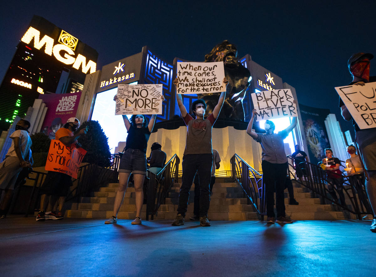 Demonstrators gather to demand justice for George Floyd along the Las Vegas Strip on Thursday, ...