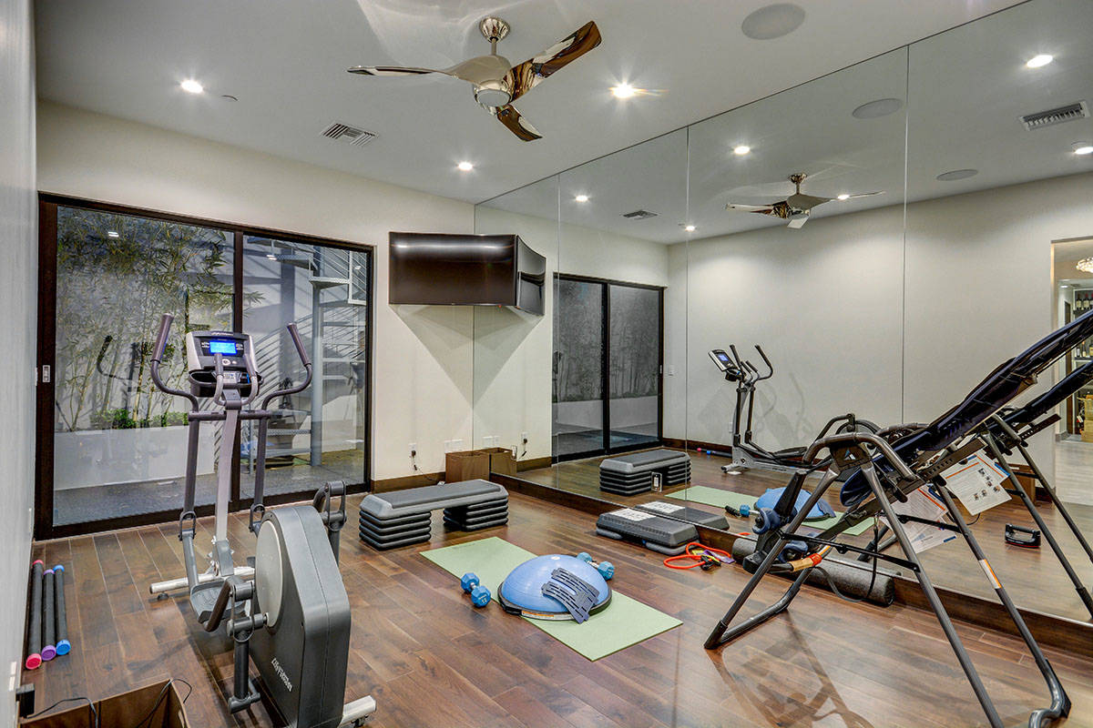 Local and regional design experts say that more luxury homes will include a home gym, like this ...