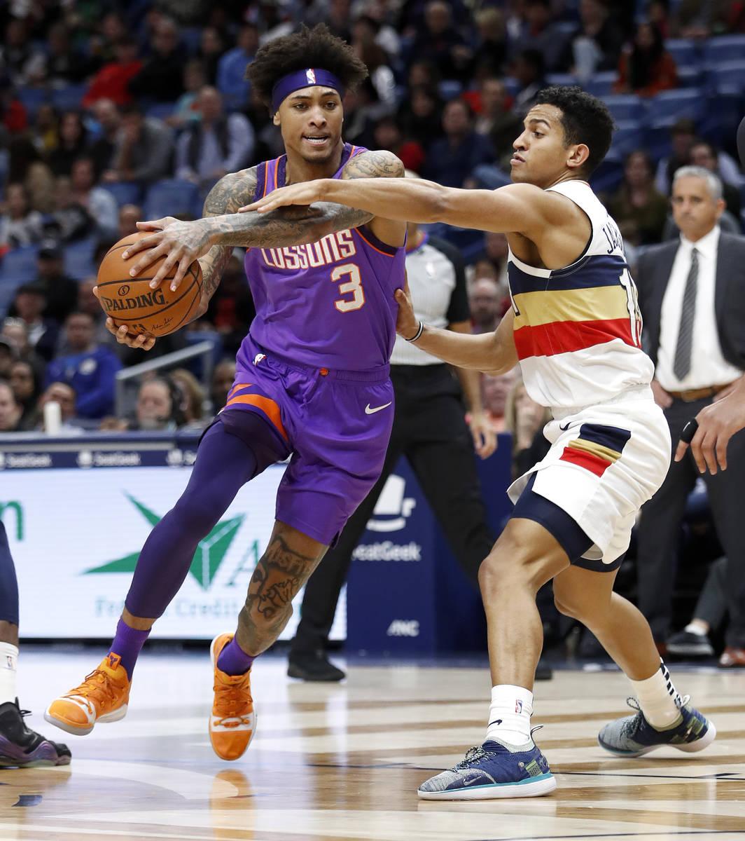 Phoenix Suns forward Kelly Oubre Jr. (3) drives past New Orleans Pelicans guard Frank Jackson ( ...