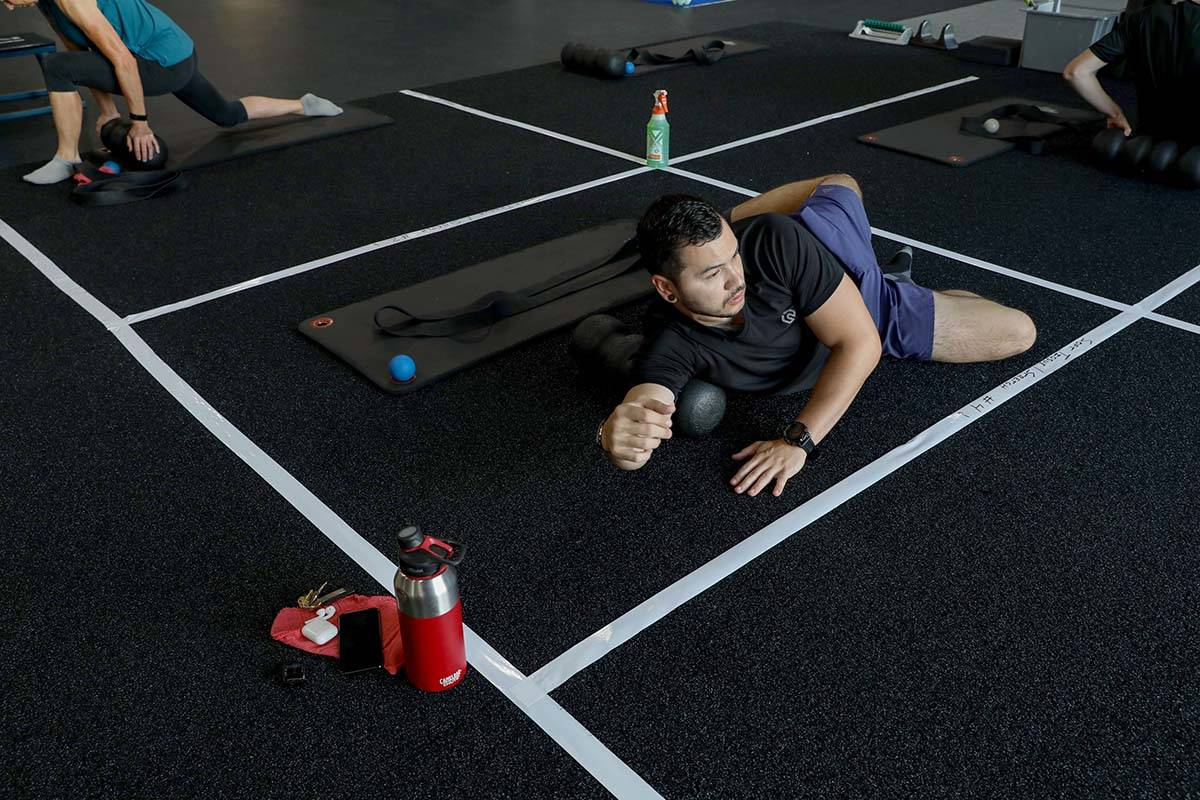 Brian Lee, member of The Gym Las Vegas, stretches while following social distancing guidelines ...
