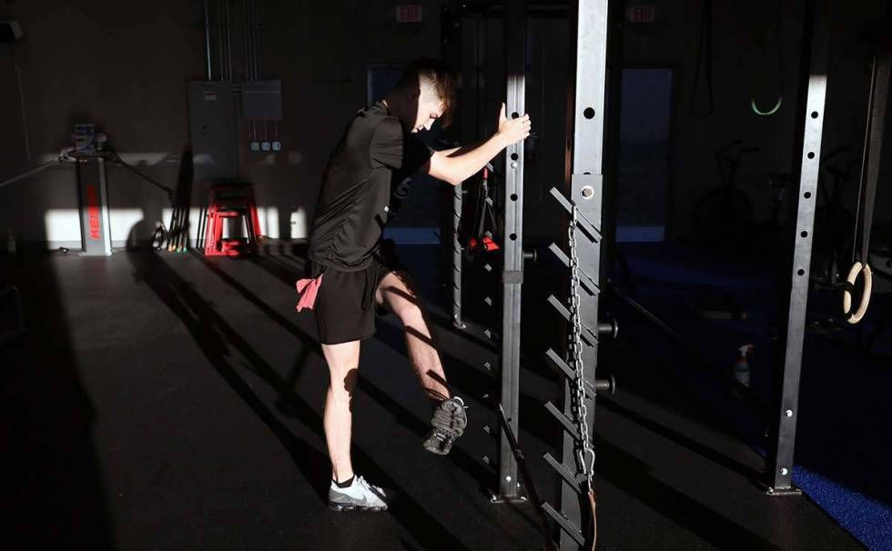 Ethan Ryan, 17, partakes in strength training while following social distancing guidelines at T ...