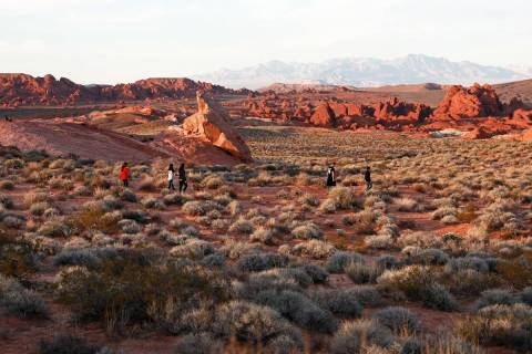 People soak in the view at the Valley of Fire State Park on Sunday in Overton, Nevada, Feb. 4, ...