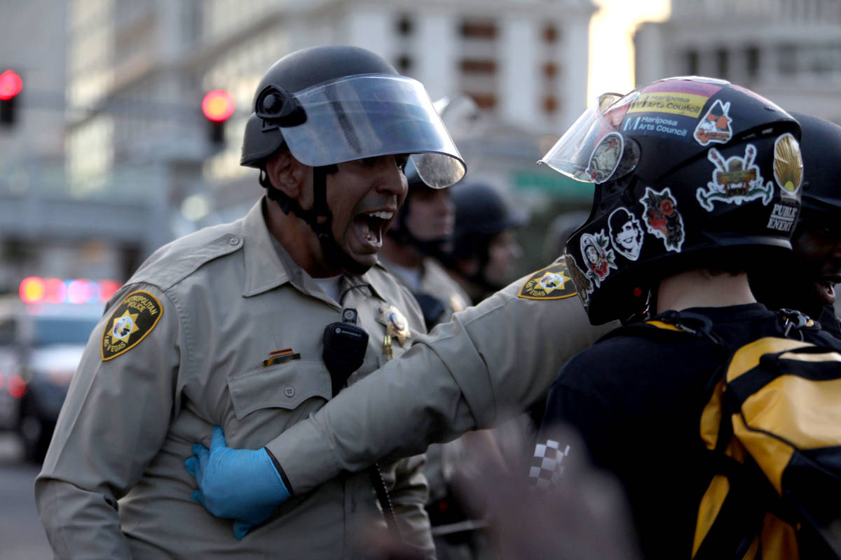 Demonstrators face off against police while demanding justice for George Floyd along the Las Ve ...