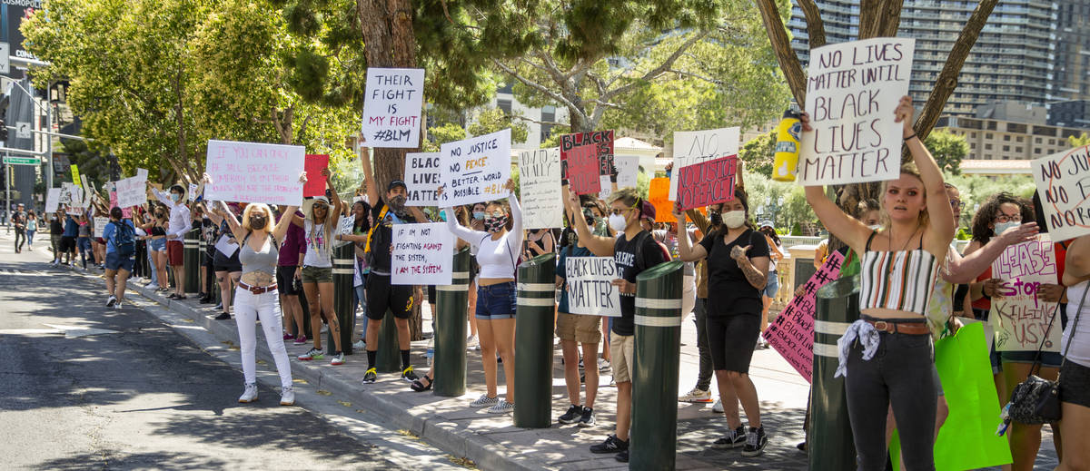 Protestors line the street near the Bellagio Fountains during a Black Lives Matter protest and ...