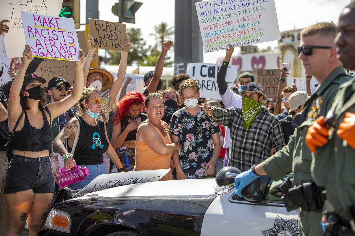 Protestors link arms while confronting the Las Vegas Police near Circus Circus during a Black L ...