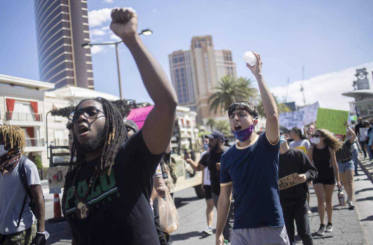 Supporters and members of the Black Lives Matter movement march down Las Vegas Boulevard in sol ...