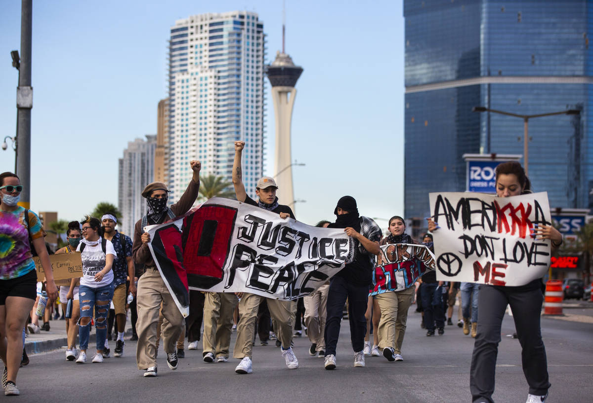 Demonstrators march to demand justice for George Floyd along the Las Vegas Strip in Las Vegas o ...