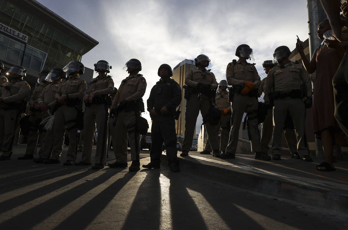 Police block the road leading to Trump Tower along the Las Vegas Strip in Las Vegas on Friday, ...