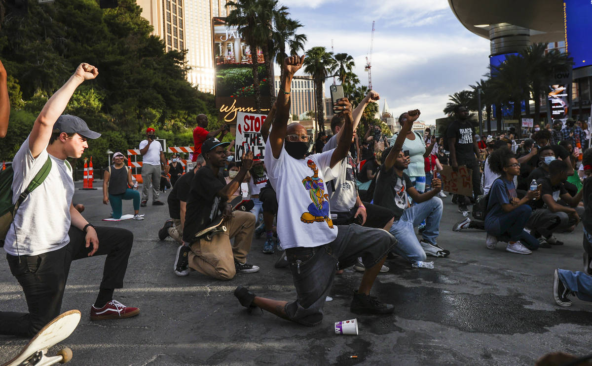 Demonstrators face off with police to demand justice for George Floyd along the Las Vegas Strip ...