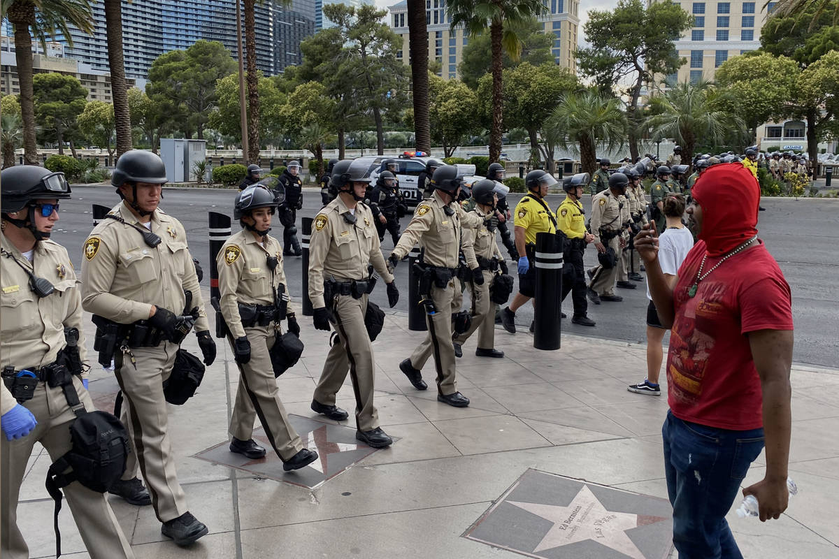 Las Vegas police officers form a line to block Las Vegas Boulevard, Friday, May 29, 2020, durin ...