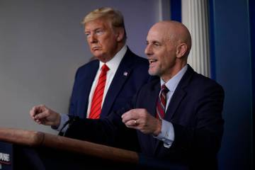 President Donald Trump, left, listens as Food and Drug Administration Commissioner Dr. Stephen ...