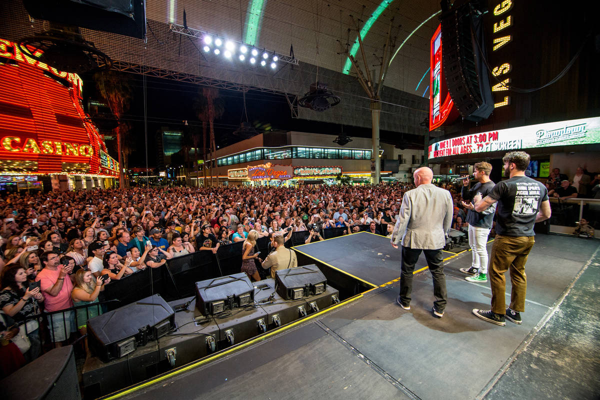 Fremont Street Experience President Patrick Hughes is shown with the Chainsmokers on 3rd Street ...