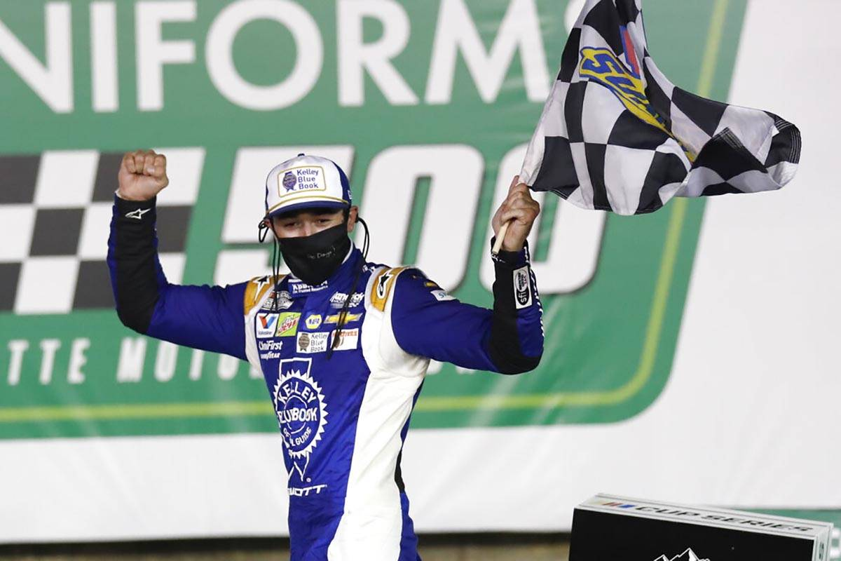 Chase Elliott celebrates after winning a NASCAR Cup Series auto race at Charlotte Motor Speedwa ...