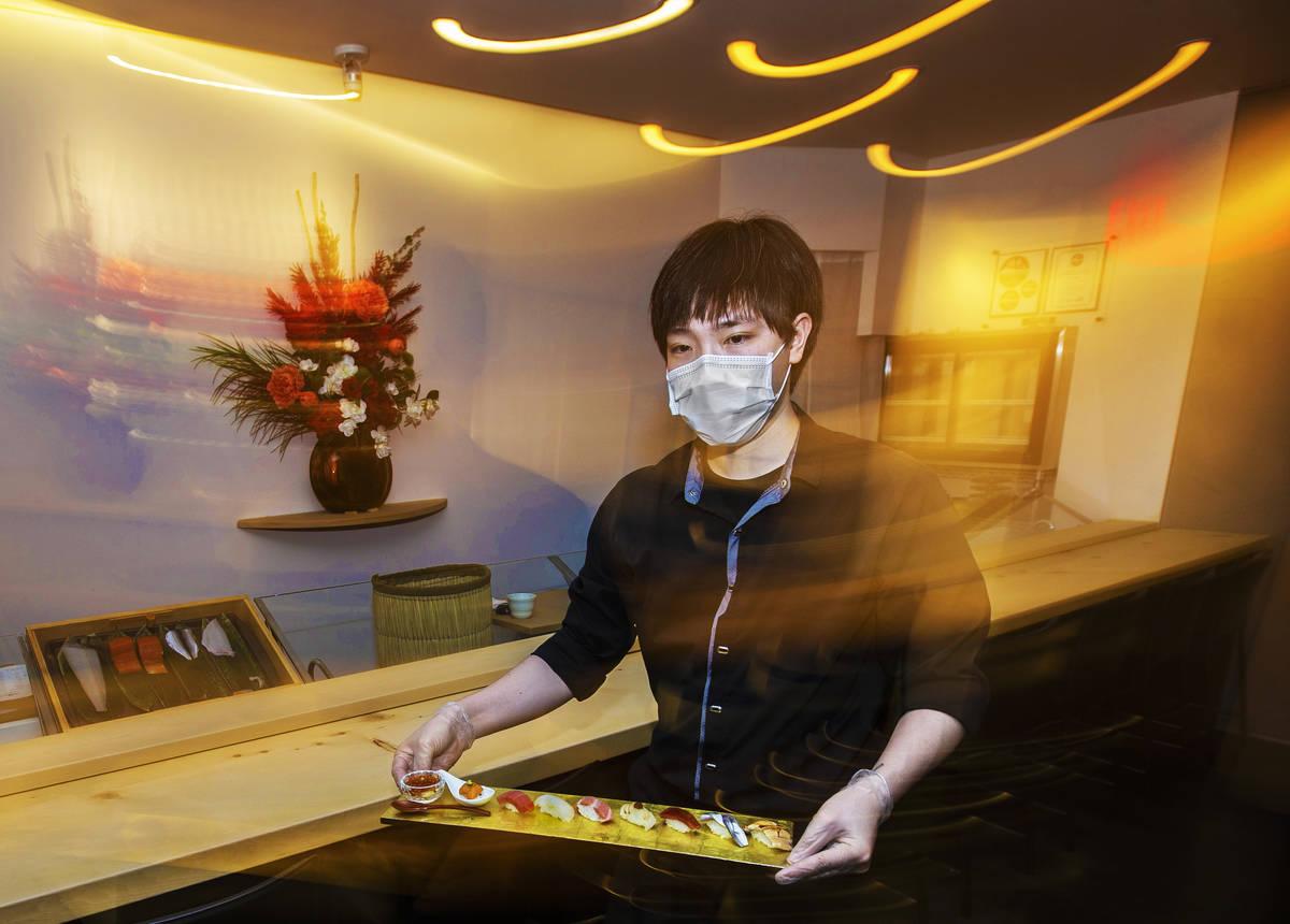 Roy Cheng serves food at Yui Edomae Sushi on Thursday, May 28, 2020, in Las Vegas. (Benjamin Ha ...