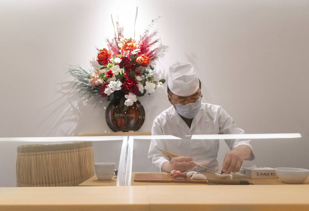Executive chef Kaz Iida prepares sushi at Yui Edomae Sushi on Thursday, May 28, 2020, in Las Ve ...